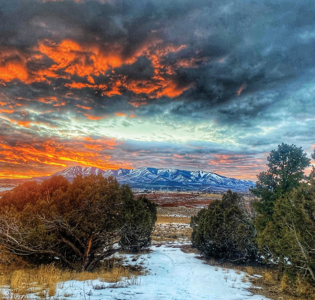 """""""I've seen fire in the sky.""""  Though John Denver was referring to the Colorado Rockies, the Abajos in San Juan County are no stranger to stunning sunsets.  Karly Halls photo"""